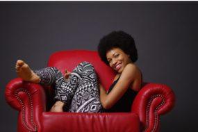 woman in armchair wearing patterned leggings