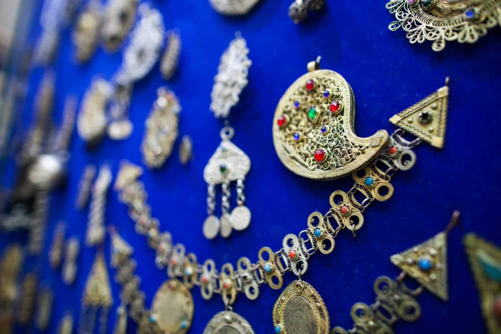 Jewelry items displayed on a blue background