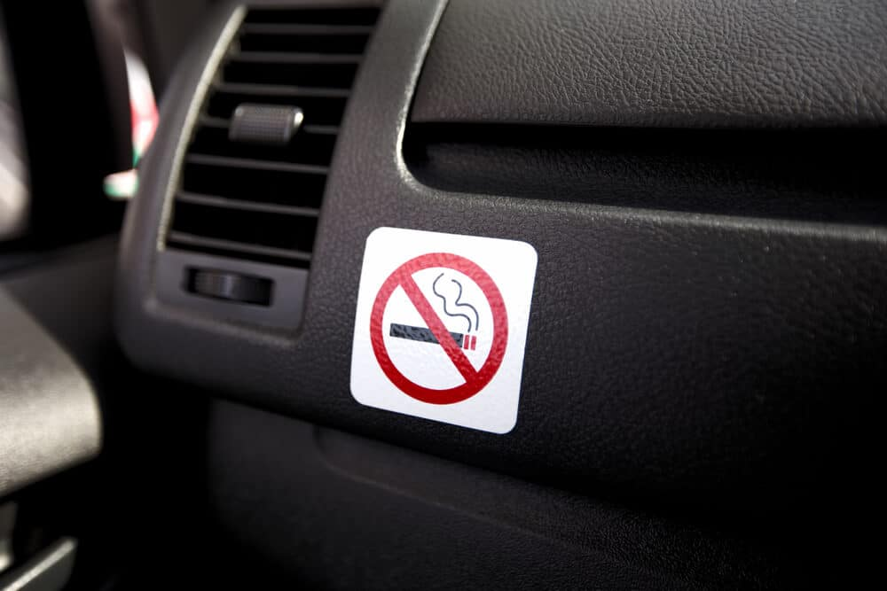 No smoking sign in a car