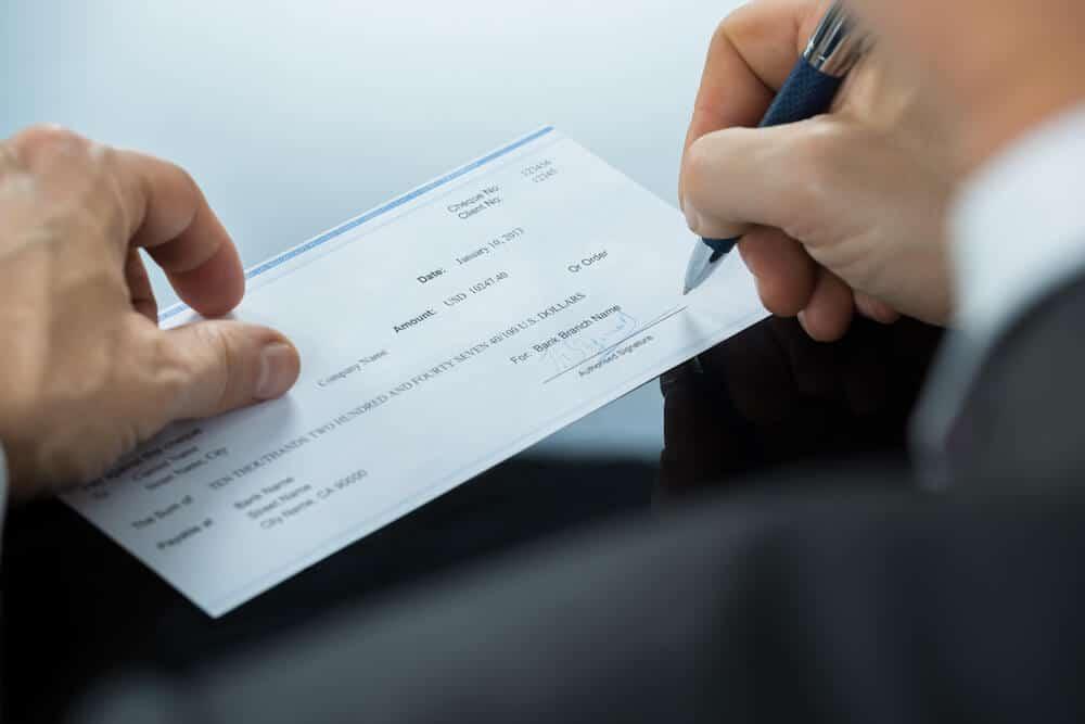 Man signing a check