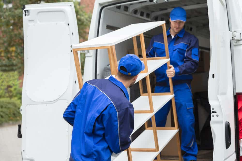 Men load a bookshelf onto a truck