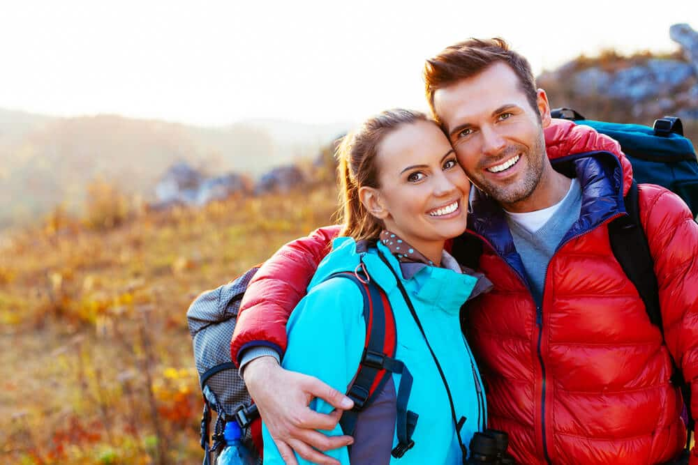 Smiling couple in outdoor clothing