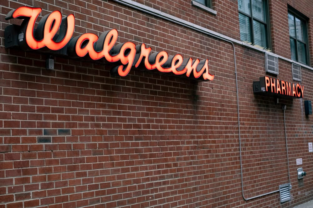 Walgreens sign on the exterior brick wall of a store