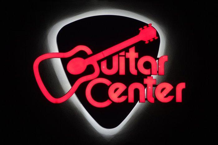 Illuminated Guitar Center logo