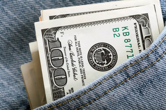 $100 bill in the pocket of a pair of jeans