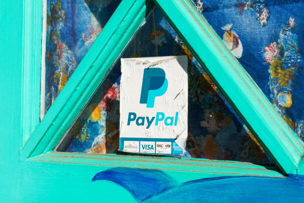 PayPal acceptance sign on the window of a restaurant