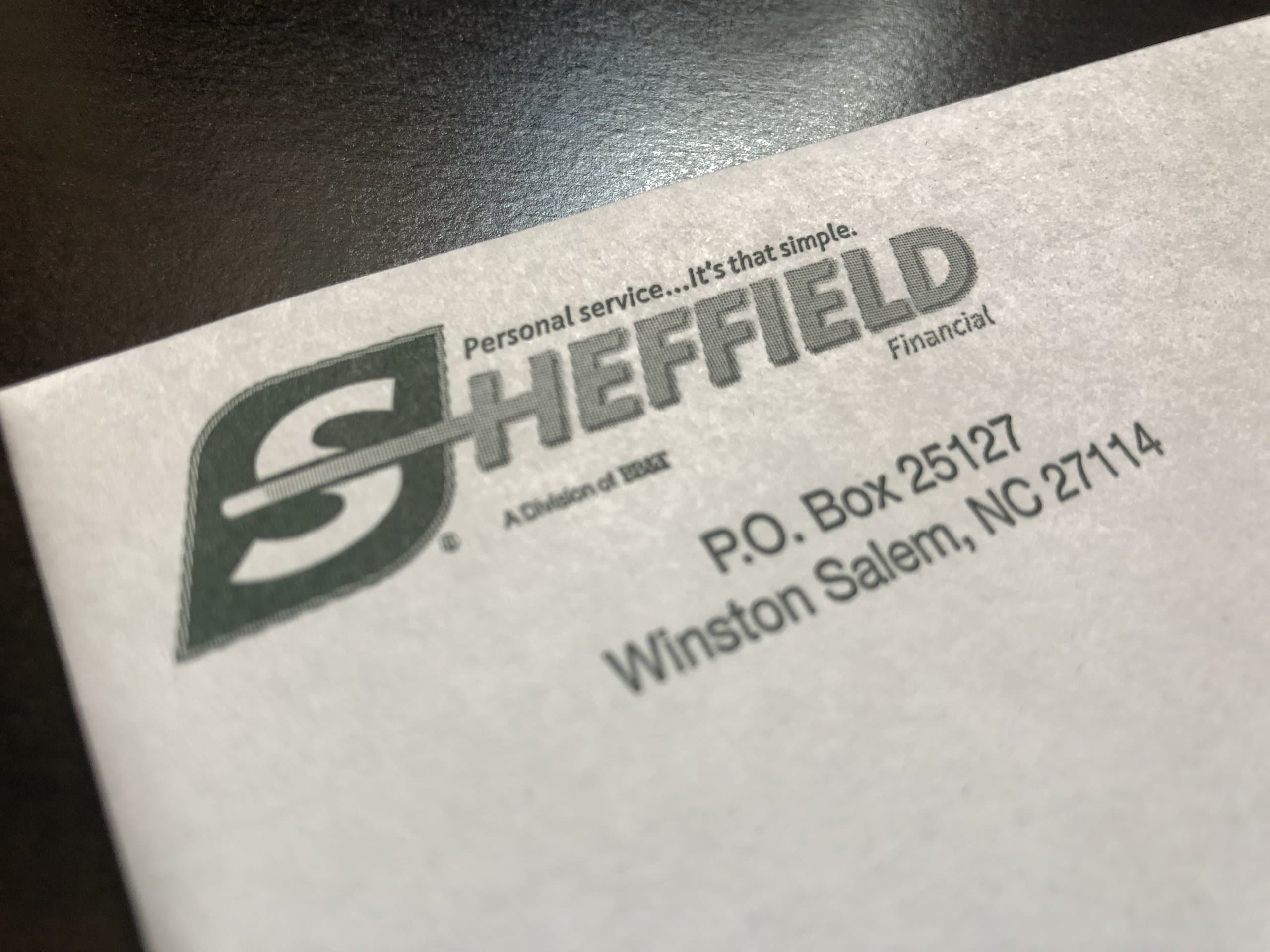 Mail from Sheffield Financial resting on a desk