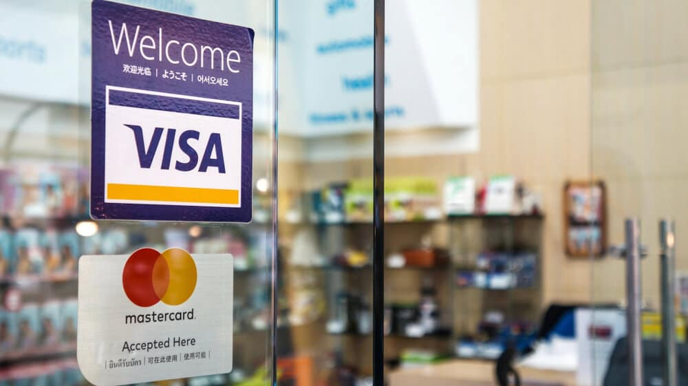 Signs showing Visa and Mastercard are accepted