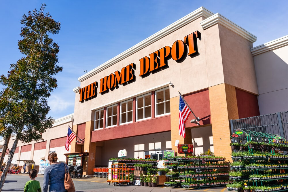 Exterior of The Home Depot on a sunny day with plants for sale