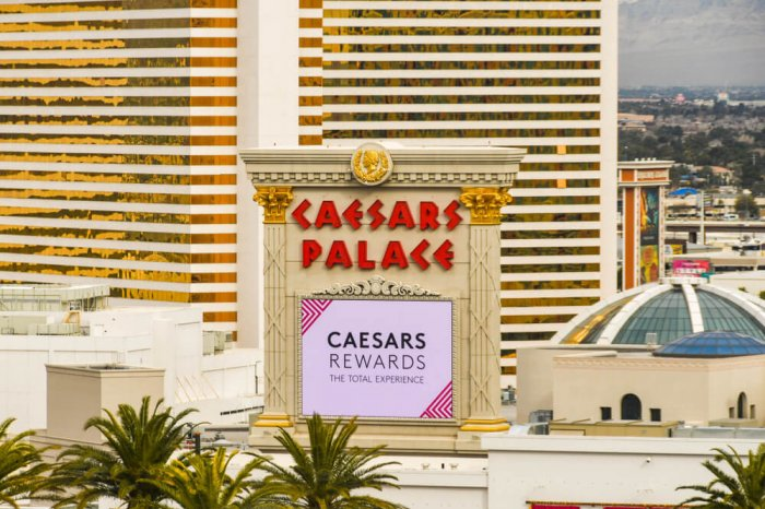 A Caesars Palace sign in Las Vegas advertising Caesars Rewards.