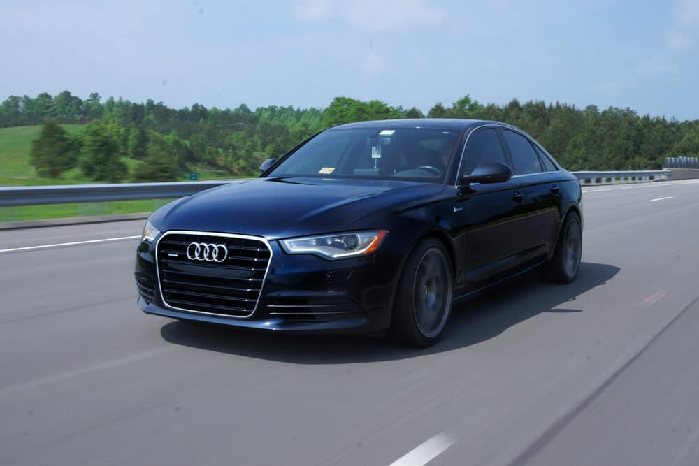 Audi car driving on a highway
