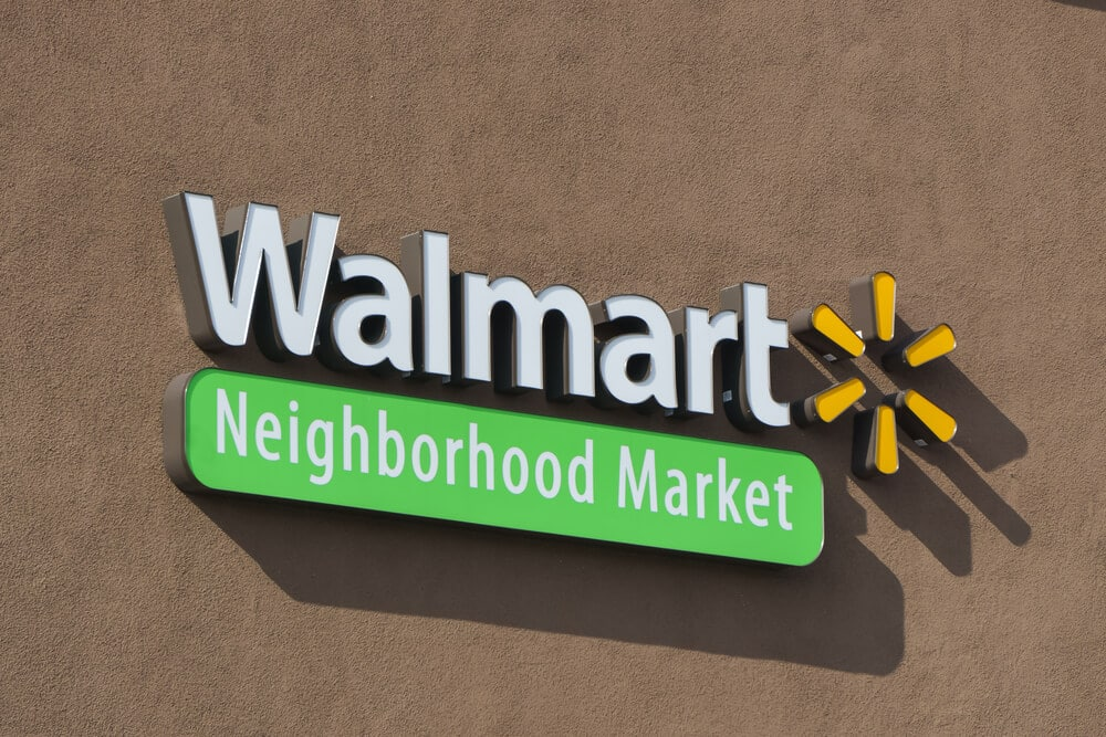 Logo sign on the outside of a Walmart Neighborhood Market store