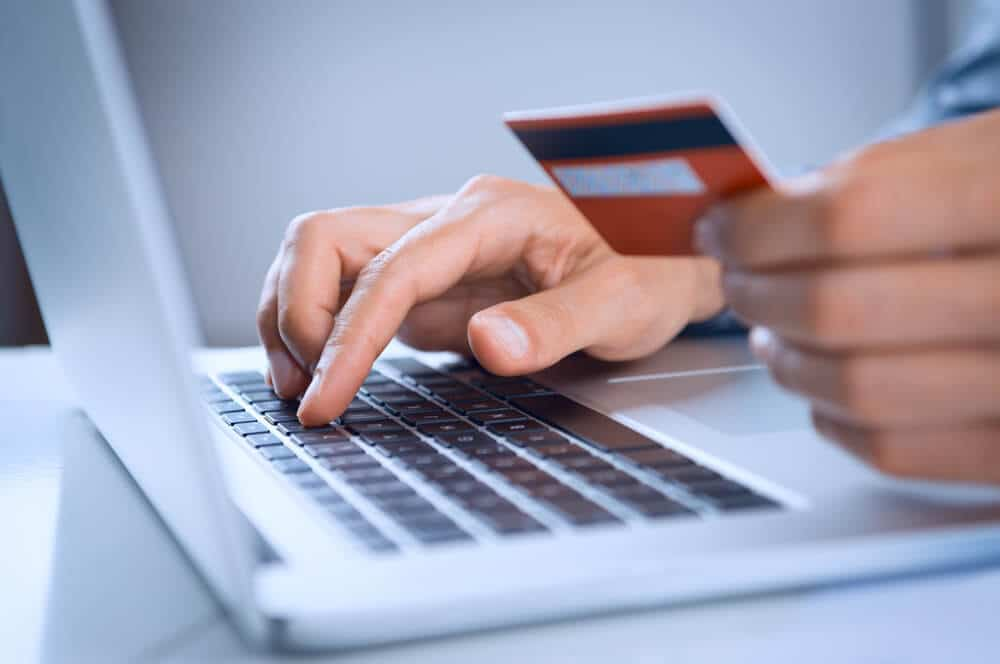 Person using MoneyPak to reload a debit card online