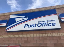 United States Postal Service sign on the outside of a post office