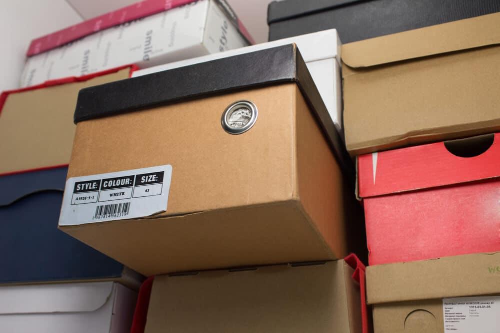 Stacks of shoe boxes on a closet shelf