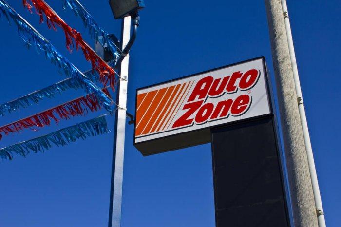 AutoZone sign against a blue sky