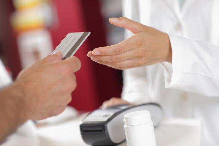 customer making an FSA card purchase at a pharmacy
