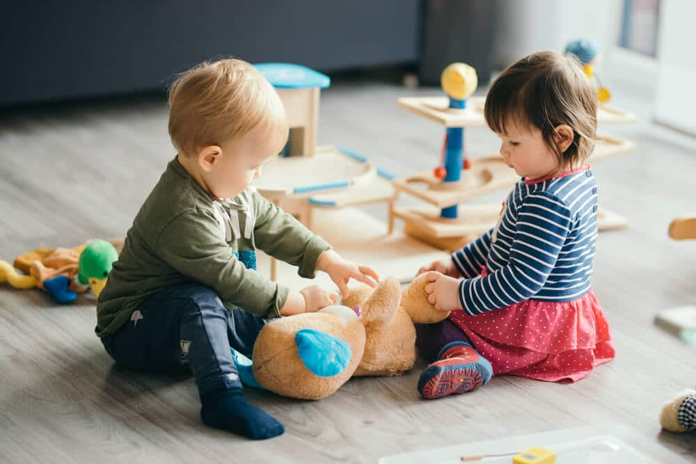 two small children playing with toys