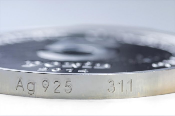 a silver coin stamped with 925
