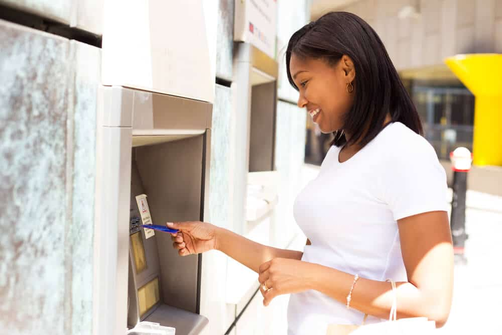 young woman withdrawing cash from an ATM